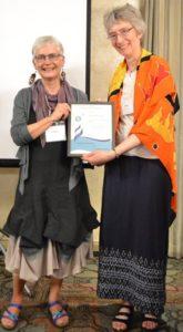 Christine Jacobson presents the 2018 Ewart-Daveluy award to Audrey McClellan