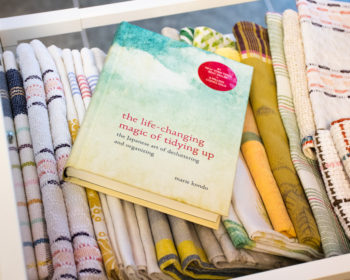 Folded towels and Marie Kondo's book